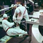 John Pace helps rotate the top of the reactor in order to remove broken pieces of melted fuel rods. The seal around the top of the reactor was cut, allowing radiation to leak from the core of the reactor.
